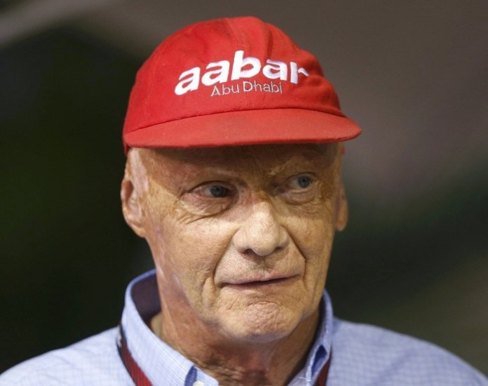 Former Formula One racing driver and three-time F1 World Champion Lauda looks on in the Red Bull garage during the Singapore F1 Grand Prix in Singapore