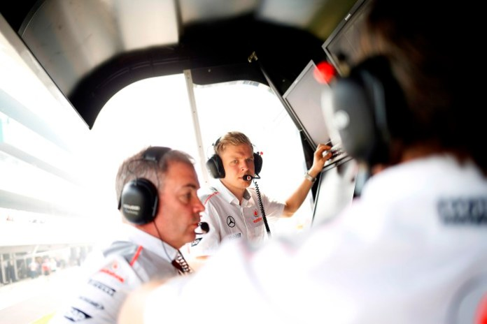 Kevin Magnussen on the pit wall