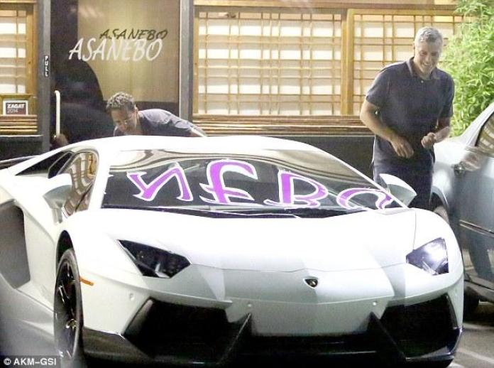 George Clooney checking out a Lamborghini Aventador