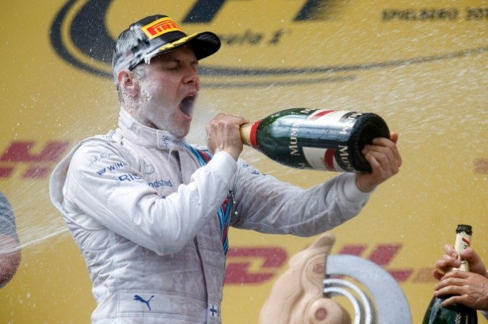 Red Bull Ring, Spielberg, Austria. Sunday 22 June 2014. Valterri Bottas, Williams F1, 3rd Position, sprays himself with Champagne on the podium. World Copyright: Alastair Staley/LAT Photographic. ref: Digital Image _R6T4863