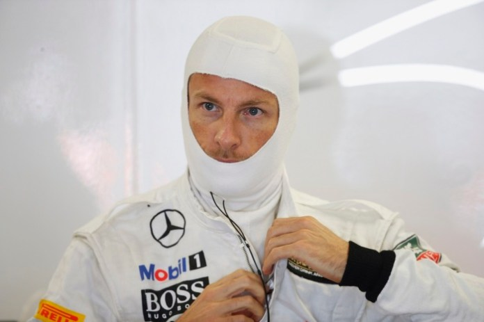 Jenson Button prepares in the garage.