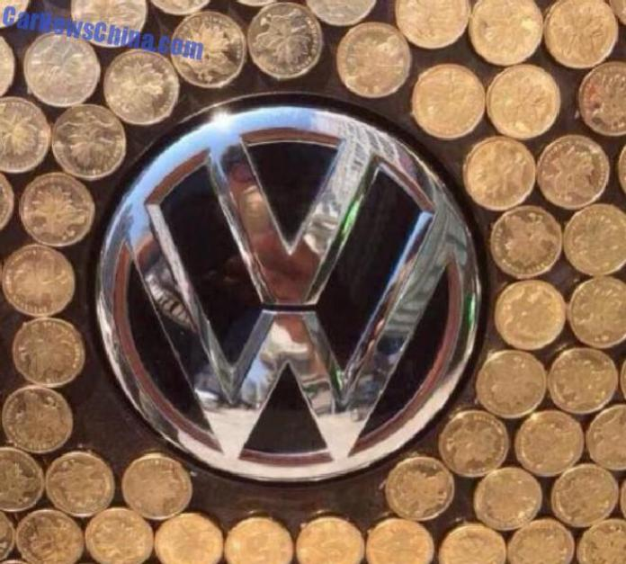 Volkswagen Beetle covered with coins (5)