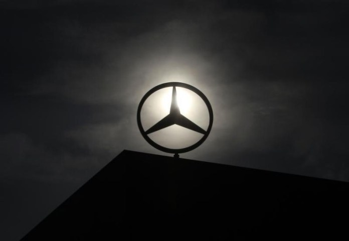 Logo of Mercedes Benz is seen on top of a car factory against the background of an overcast sky in the central Hungarian town of Kecskemet