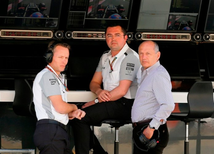 Sam Michael, Eric Boullier and Ron Dennis in the pits.