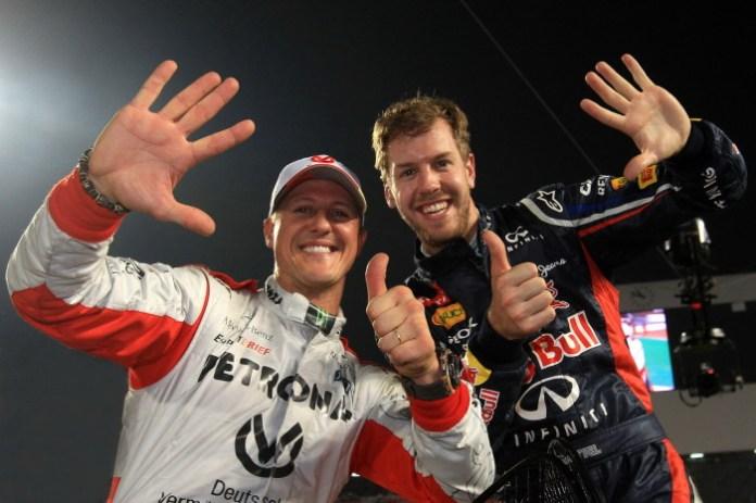 Michael-Schumacher-and-Sebastian-Vettel-celebrate-