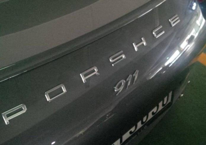 Porsche 911 with misspelled logo