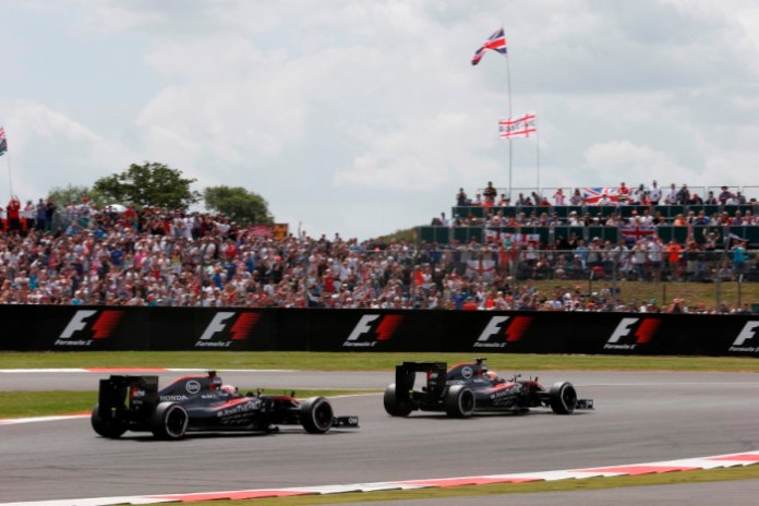 Fernando Alonso leads Jenson Button.