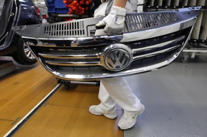 vw logo volkswagen workers employee