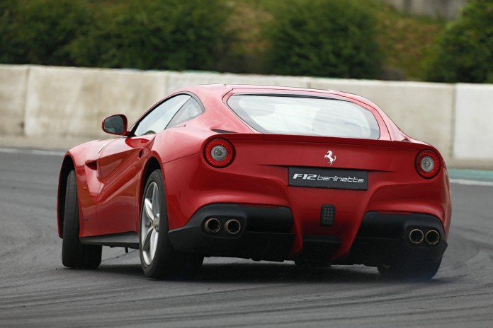 Sebastian Vettel with the Ferrari F12berlinetta