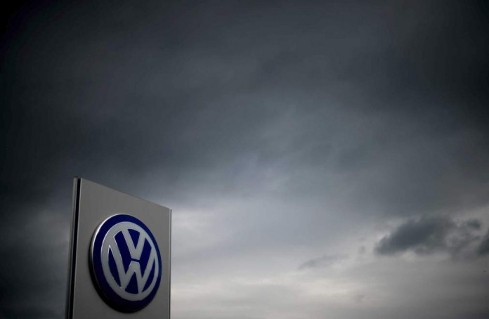 The logo of German car maker Volkswagen can be seen as dark clouds hang in the sky over a Volkswagen trader in Hanover, central Germany, on September 22, 2015. Share prices on the Frankfurt stock exchange fell more than 3.0 percent in midday trading on September 22, 2015, pushed down by index heavyweight Volkswagen, as it ploughed ever deeper into a pollution cheating scandal.   AFP PHOTO / DPA / JULIAN STRATENSCHULTE   +++   GERMANY OUT        (Photo credit should read JULIAN STRATENSCHULTE/AFP/Getty Images)