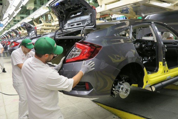 Honda of Canada Mfg. associates install a rear bumper