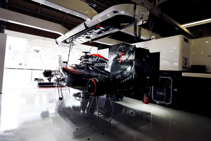 The McLaren Honda MP4-30 of Fernando Alonso in the garage.