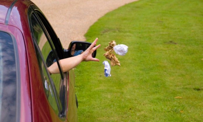 Person Throwing Litter From Car Window. Image shot 08/2008. Exact date unknown.