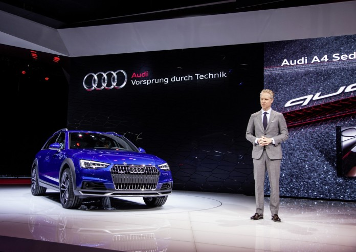 Scott Keogh, President, Audi of America, next to the Audi A4 allroad quattro at the 2016 North American Auto Show in Detroit.