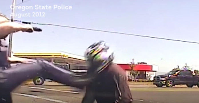 Dashcam Captures Oregon Cop Violently Kicking Motorcyclist AJ+