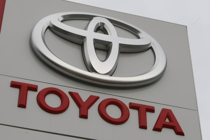 a-huge-toyota-logo-stands-at-a-car-dealership-1