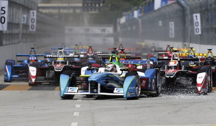 Drivers leave the starting grid during the Formula E Championship race in Putrajaya November 22, 2014. The FIA Formula E Championship is the world's first fully electric racing series. REUTERS/Olivia Harris (MALAYSIA - Tags: SPORT MOTORSPORT TPX IMAGES OF THE DAY)