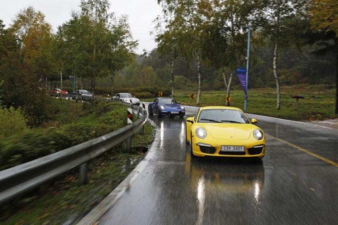 a-convoy-of-five-porsche-911s-speeding-through-the-south-korean-countryside1