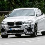The 2015 BMW X6 M spotted with bare minimum camouflage