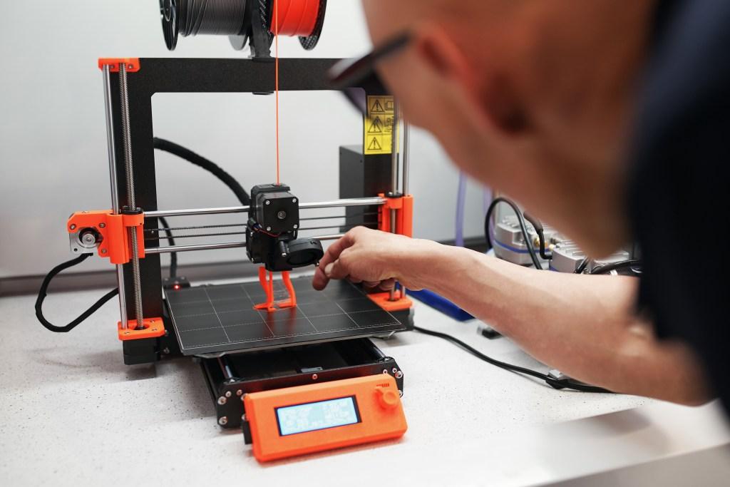 man-checking-3d-printer
