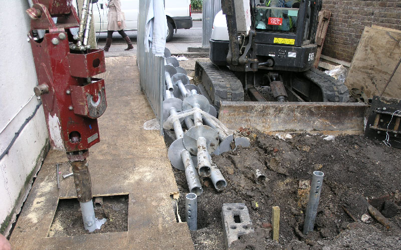 2500X Torque Head installing 89R Screw Piles for Underpinning