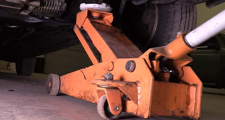 How To Lift A Vehicle And Support It Using Floor Jacks 8