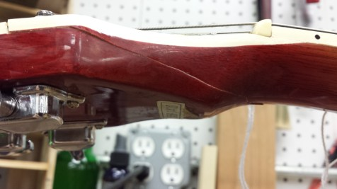 Bad looking neck repair on a Les Paul copy.