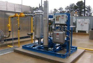 <p>One of the components of a natural gas fueling station is a dryer (pictured). Replacement of these components should be taken into consideration when calculating the total cost of CNG. <em>Photo courtesy of ET Environmental.</em></p>