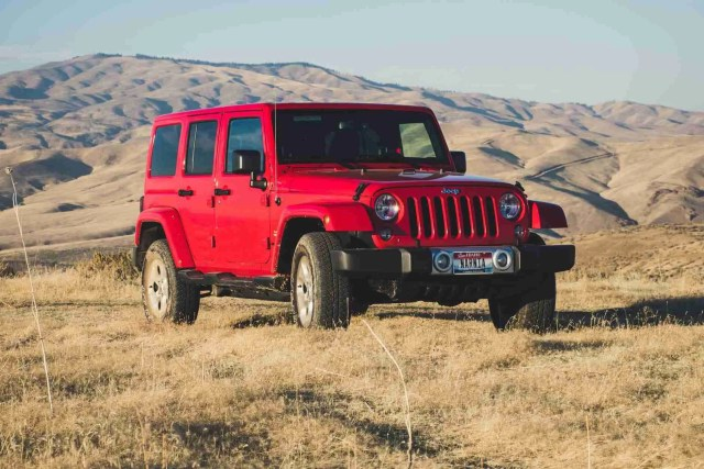 red jeep wrangler suv on outdoors not a cheap small 4x4