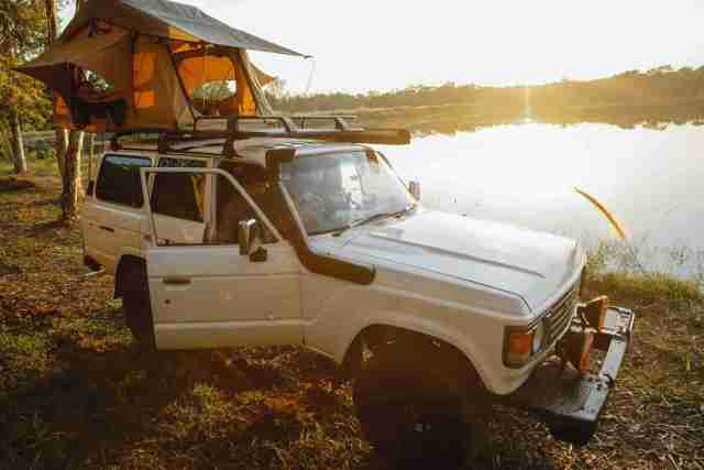 Toyota Landcruiser Overland suv car parked near lake at campsite not the cheapest small 4x4
