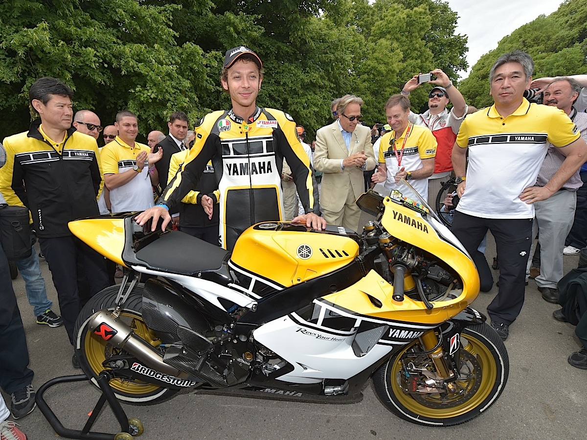 CHICHESTER, ENGLAND - JUNE 28:  Valentino Rossi (C) unveils the Yamaha 60th anniversary bike alongside Yamaha officials during the Festival of Speed on June 28, 2015 in Chichester, England.  (Photo by Charles McQuillan/Getty Images for Yamaha Motor Co., LTD)
