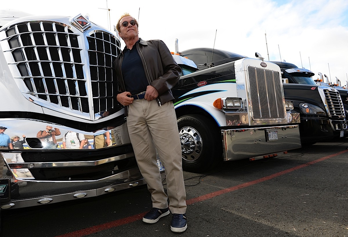 SONOMA, CA - JUNE 28:  Actor and former governor of California Arnold Schwarzenegger poses for a picture in front of a hauler prior to the NASCAR Sprint Cup Series Toyota/Save Mart 350 at Sonoma Raceway on June 28, 2015 in Sonoma, California.  (Photo by Robert Laberge/Getty Images) *** Local Caption *** Arnold Schwarzenegger