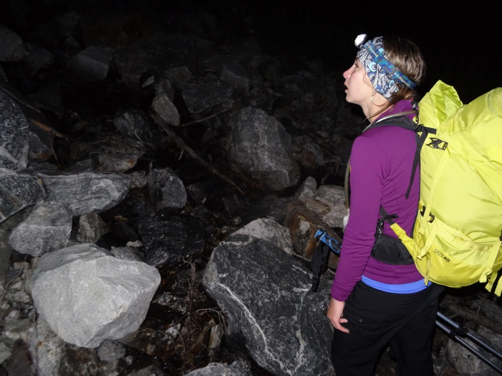 Kelly assesses the long journey through boulderfields in the dark ahead of her.