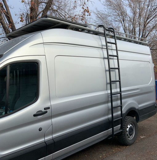 Ford Transit with Avatar roof rack and side ladder