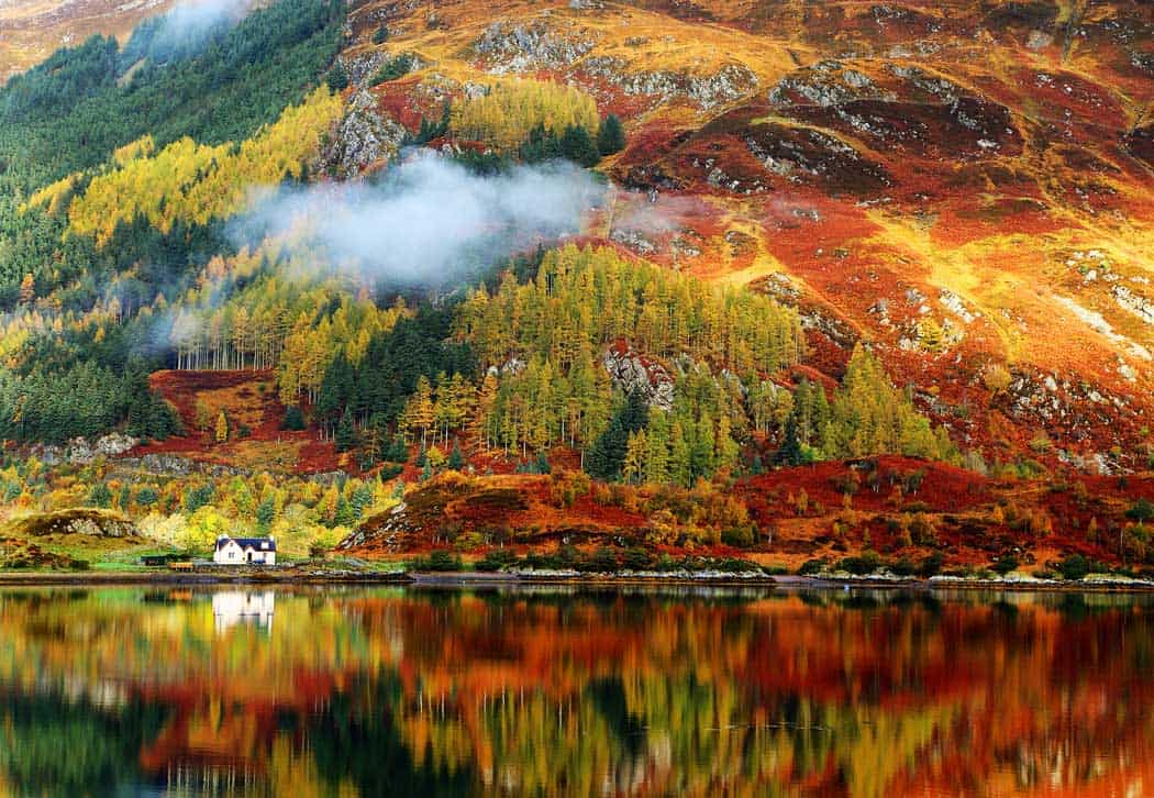 Gorgeous autumn colors in the Highlands. Oh what I would give to live in that house! Cliick through to see 28 mind blowing photos of Scotland!