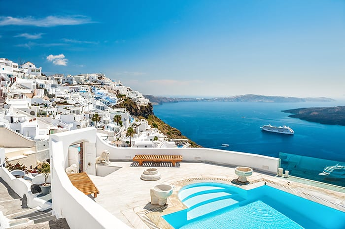Resort Hotel, Santorini, Greece! The contrast of the beautiful dark blue ocean water and white buildings on the Santorini coast make it one of the most striking on earth. Click through to see 20 of the BEST pools on earth!