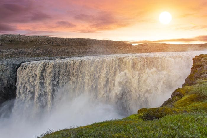Dettifoss waterfall is located in Vatnajökull National Park in Northeast Iceland. It is the largest waterfall in Europe in terms of water flow, and is said to be the most powerful as well. Click through to see 15 of Iceland's BEST waterfalls!