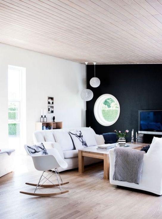 sejour-scandinave-fentre-ronde-mur-noir-aventuredeco
