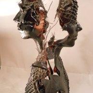 "Mari Meszaros, ""The light charm of ignorance"", twee torso's, smelttechniek, hoog 66 cm."