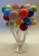'Carnaval', aan de brander geblazen balonnetjes, met touwlintjes opgelaten, hoog 20 cm.