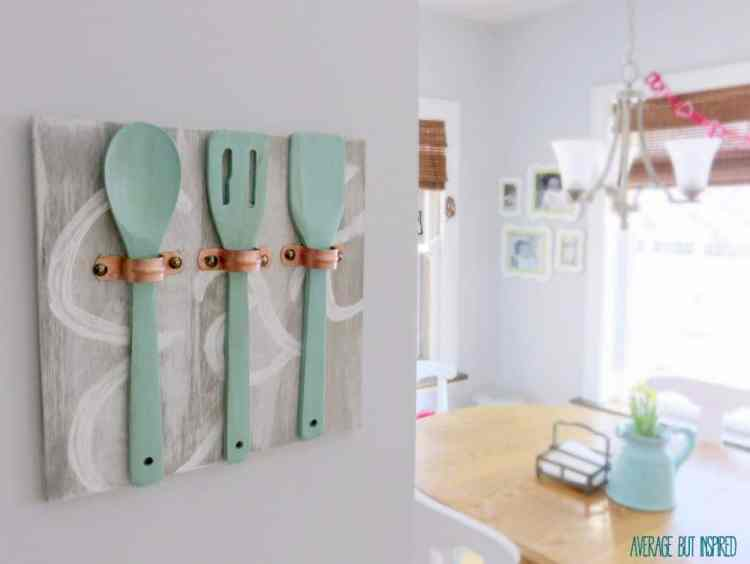Average But Inspired shows you how to make unique art for your kitchen using copper pipe straps, wooden utensils and some paint!