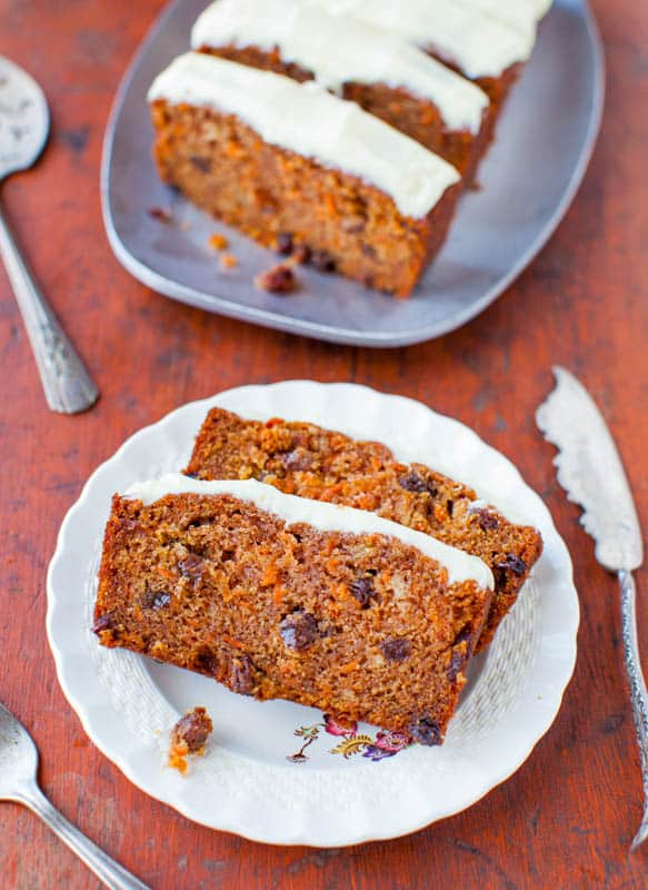 Slices of carrot cake loaf on a white plate.