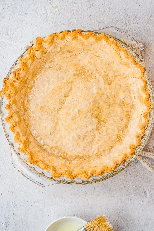 Easy Flaky All Butter Pie Crust - This perfect pie crust is so FLAKY and BUTTERY! It's EASY, no-fuss, and foolproof! It's great pre-baked to use in no-bake pies or for double-crust pies!