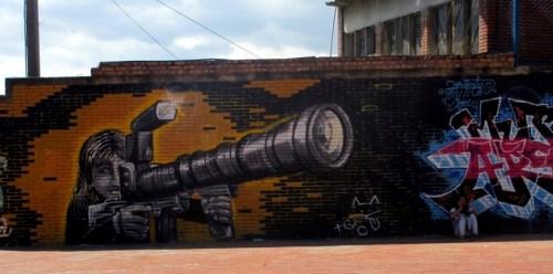 camera gun graffiti