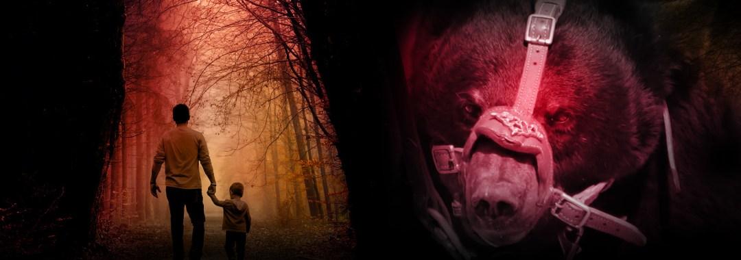 un homme tourne le dos avec son fils face à un ours muselé