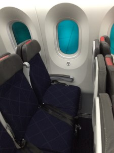 Row 16 with cloth seats and window tinted. Each seat offers generous recline with seat back entertainment.