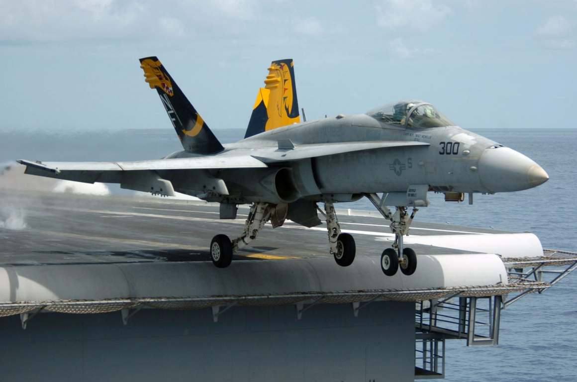 """050817-N-3488C-028 Pacific Ocean (Aug. 17, 2005) - An F/A-18C Hornet, assigned to the """"Golden Dragons"""" of Strike Fighter Squadron One Nine Two (VFA-192), launches from the flight deck of the conventionally powered aircraft carrier USS Kitty Hawk (CV 63). Kitty Hawk and embarked Carrier Air Wing Five (CVW-5) are currently returning to their homeport after a scheduled deployment in the 7th Fleet area of responsibility. U.S. Navy photo by Photographer's Mate 3rd Class Jonathan Chandler (RELEASED)"""