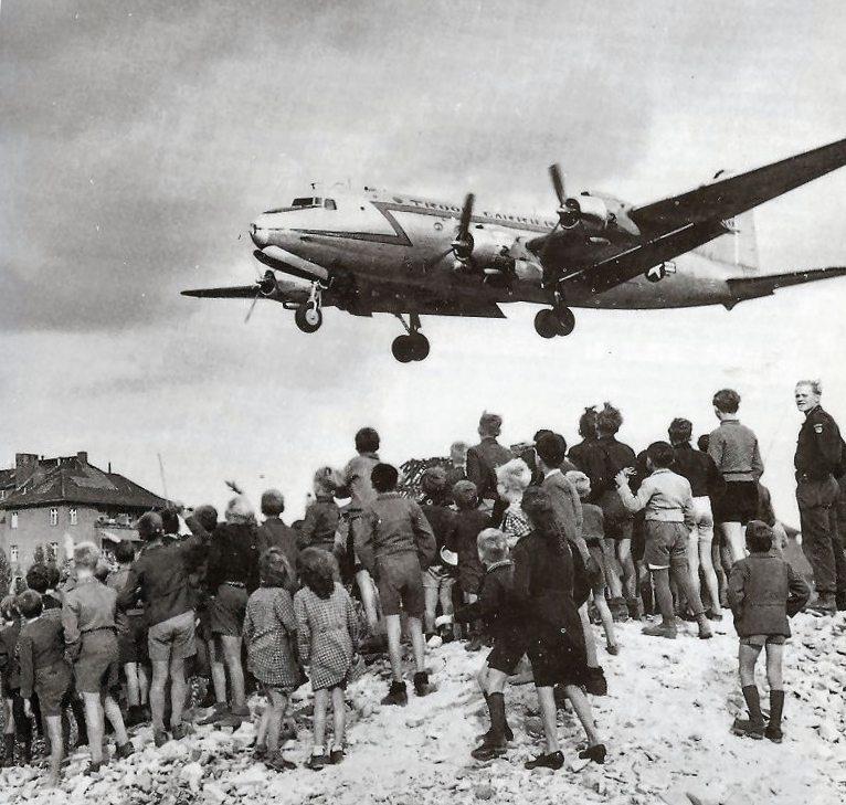 Berliners watch as a C-54 arrives in Berlin in 1948.
