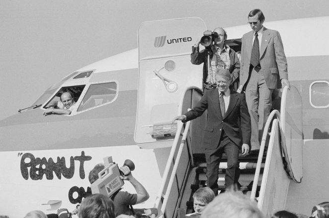 Jimmy Carter greets press as he steps off of Peanut One, a Boeing 727 during the 1977 campaign.