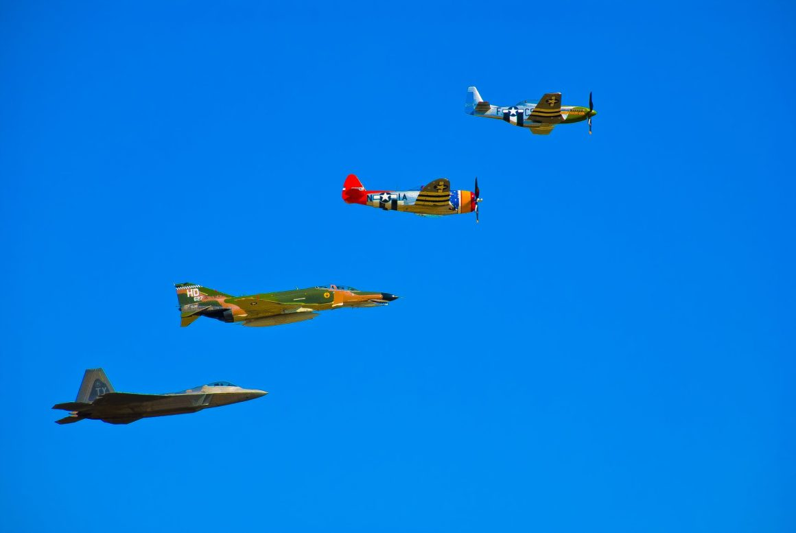 An Example of a Heritage Flight including the P-51 Mustang, P-47 Thunderbolt, the QF-4 Phatom and the F-22 Raptor (Photo: Landmark9254)